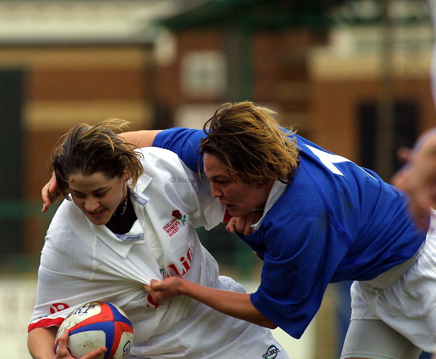 Photo : Garvin Davies.England v France Womens 6 Nations Championships,08-04-01 @ Northampton R.F.C.England outside-half Shelley Rae gets caught by French flanker Corinne Bessellere.