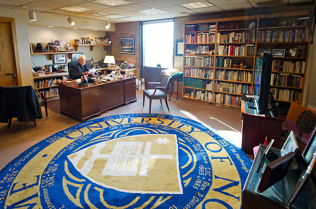 Nov. 21, 2013; Fr. Ted Hesburgh reads letters in his office in the Hesburgh Library.<br /> <br /> Photo by Matt Cashore