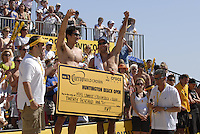 Huntington Beach, CA - 5/6/07:  Mike Lambert, left, and Stein Metzger recieve a check for $20,000 after winning the championship match of the AVP Cuervo Gold Crown Huntington Beach Open of the 2007 AVP Crocs Tour..Photo by Carlos Delgado