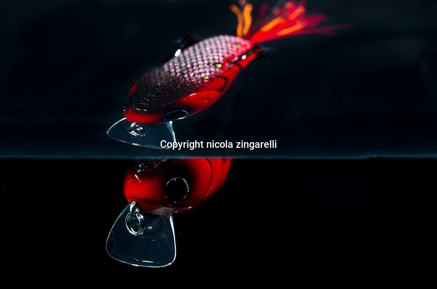 Molix's Supernato Lure shot in a fish tank with two light, black background and reflected image
