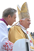 Pope Benedict XVI personal secretary Mons. Georg Gaenswein  waves during a canonization mass in St. Peter's square, Vatican, 17 October 2010. The pope formally recognized Australia's first saint, Sister Mary MacKillop, who is revered as a pioneer of education in Outback Australia and the founder of the Sisters of St Joseph of the Sacred Heart. She was canonised along with Stanislaw Soltys of Poland, Andre Bessette of Canada, Candida Maria de Jesus Cipitria y Barriola of Spain, and Italians Giulia Salzano and Battista da Varano.