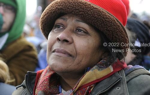 Wilmington, DE - January 17, 2009 -- A supporter listens as United States President-elect Barack Obama delivers remarks at a rally in Wilmington, Delaware, where Obama picked up Biden, on the Whistle Stop Train Tour, on January 17, 2009. The ceremonial trip will carry President-elect Obama, Vice President-elect Biden and their families to Washington for their inaugurations with additional events in Philadelphia, Wilmington and Baltimore. Obama will be sworn in as the 44th President of the United States on January 20, 2009..Credit: Kevin Dietsch - Pool via CNP