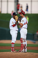 Peoria Chiefs pitcher Dewin Perez (41) talks with catcher Steve Bean (8) during a game against the Wisconsin Timber Rattlers on August 21, 2015 at Dozer Park in Peoria, Illinois.  Wisconsin defeated Peoria 2-1.  (Mike Janes/Four Seam Images)