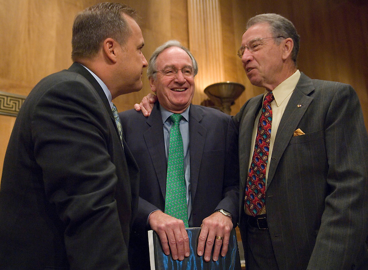 From left, Jim Nussle, nominee to be director of the Office of Management and Budget, speaks with Sen. Tom Harkin, D-Iowa, and Sen. Chuck Grassley, R-Iowa, before the start of his confirmation hearing in the Senate Homeland Security and Governmental Affairs Committee on Tuesday, July 24, 2007. Sens. Harkin and Grassley introduced their fellow Iowan to the committee.?