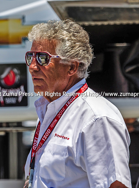 Mario Andretti watches the action during qualifying for the IZOD Indycar Firestone 550 race at Texas Motor Speedway in Fort Worth,Texas. IZOD Indycar driver Alex Tagliani (98) driver of the Team Barracuda-BHA car qualifies in the top spot during the Firestone 550 race..