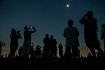 People watching and photographing total solar eclipse, Madras, Oregon