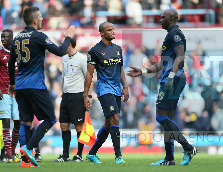 Manchester City's Vincent Kompany looks on dejected at the final whistle<br /> <br /> Barclays Premier League - West Ham United vs Manchester City - Upton Park - England - 25th October 2014 - Picture David Klein/Sportimage