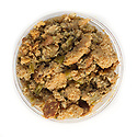 Uncooked holiday turkey stuffing mix in a takeout container to enjoy at home