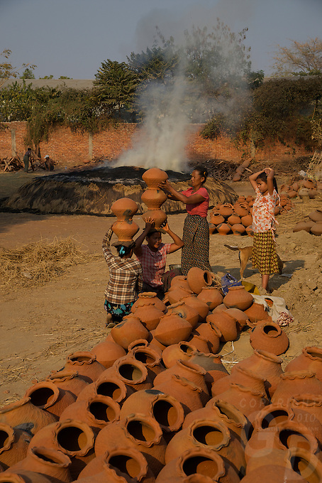 Women carrying Pots at a Pottery in Sagaing, Mandalay Myanmar/Burma