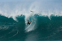 Japanese Surfer wiping out at Pipeline on the North Shore in Hawaii
