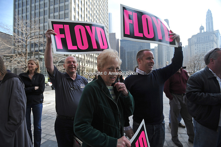 "The family of Kevin Floyd, 30, who had the winning entry in a contest sponsored by Chicago Tribune columnist John Kass and the paper to name former Illinois Governor Rod Blagojevich's memoir cheer him on outside the Tribune Tower in Chicago, Illinois on March 6, 2009.  The winning entry, Rod and the Giant Impeach, surged ahead in the final minutes the online contest was open, leading Kass to speculate on Chicago-style tactics in his column; Floyd was awarded a beef tongue ""in symbolic anticipation"" that the former governor will ""sing to the feds."""