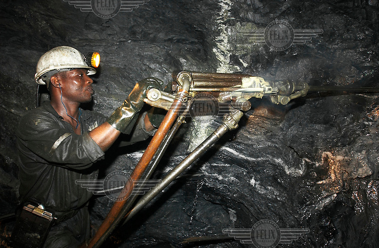 Workers of Ashanti Goldfields at the Obuasi gold mine. Ashanti recently merged with industry giant AngloGold.