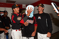 Batavia Muckdogs Jordan Holloway (left) pies starting pitcher Gabriel Castellanos (center) as Scott Squier (right) looks on after Batavia defeated Mahoning Valley 1-0 on June 24, 2015 at Dwyer Stadium in Batavia, New York.  Castellanos, Brett Lilek and Steven Farnworth combined on a perfect game, the first in the teams 76 year history.  (Mike Janes/Four Seam Images)