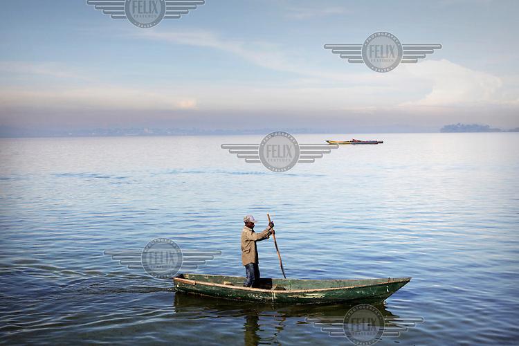 A fisherman paddles his pirogue on Lake Victoria near Kampala.