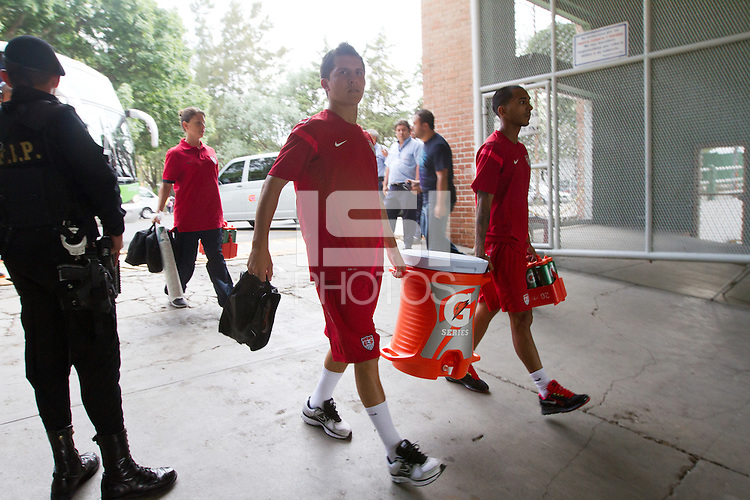 United States Men's National team players Jose Torres and Santiago Castillo carry a Gatorade bucket into Estadio Mateo Flores before their practice in Guatemala City, Guatemala on Mon. June 11, 2012.