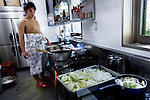 Tokyo, April 26 2013 - Young wrestler Ginseizan Takahiro, 20, cooking for the older wrestler at Otakebeya sumo stable.