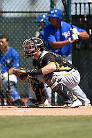 Pittsburgh Pirates catcher Kevin Krause (27) during a minor league spring training game against the Toronto Blue Jays on March 21, 2015 at Pirate City in Bradenton, Florida.  (Mike Janes/Four Seam Images)