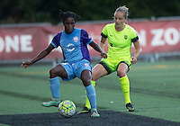 Seattle, WA - Saturday July 23, 2016: Jasmyne Spencer, Elli Reed during a regular season National Women's Soccer League (NWSL) match between the Seattle Reign FC and the Orlando Pride at Memorial Stadium.