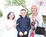 Roisín, Emmet and Yvonne Connor at Termonfeckin NS Communion ....Photo NEWSFILE/Jenny Matthews.(Photo credit should read Jenny Matthews/NEWSFILE)....This Picture has been sent you under the condtions enclosed by:.Newsfile Ltd..The Studio,.Millmount Abbey,.Drogheda,.Co Meath..Ireland..Tel: +353(0)41-9871240.Fax: +353(0)41-9871260.GSM: +353(0)86-2500958.email: pictures@newsfile.ie.www.newsfile.ie.FTP: 193.120.102.198.