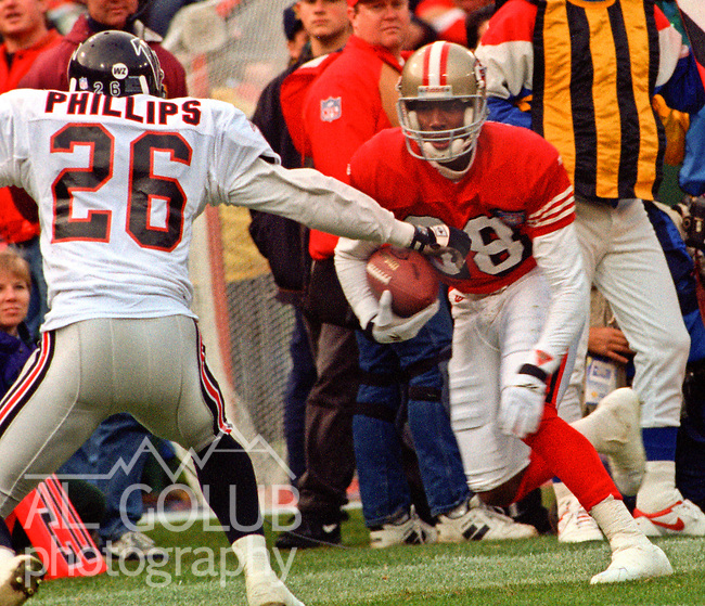 San Francisco 49ers vs. Atlanta Falcons at Candlestick Park Sunday, December 4, 1994.  49ers beat Falcons 50-14.  San Francisco Nate Singleton (88) is forced out of bounds by Atlanta Falcons defensive back Anthony Phillips (26).