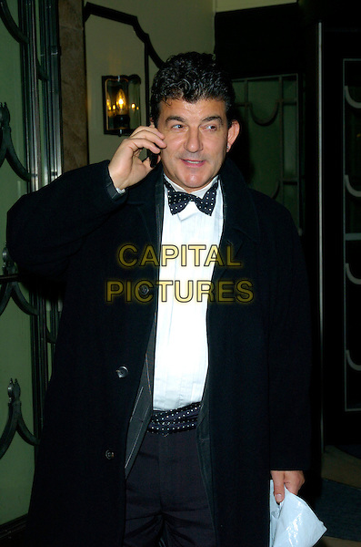 JOHN ALTMAN.Attending The Celebrities Guild Unsung Heores Awards Presentation Gala & Evening, Claridge's Hotel, London, England, October 14th 2007..half length black jacket coat bow tie talking on mobile phone                                                                    .CAP/CAN.©Can Nguyen/Capital Pictures