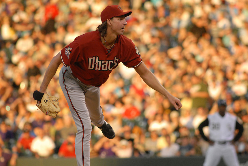 12 August 08: D'backs pitcher Randy Johnson follows through on a pitch during a game between the Arizona Diamondbacks and the Colorado Rockies at Coors Field in Denver, Colorado.