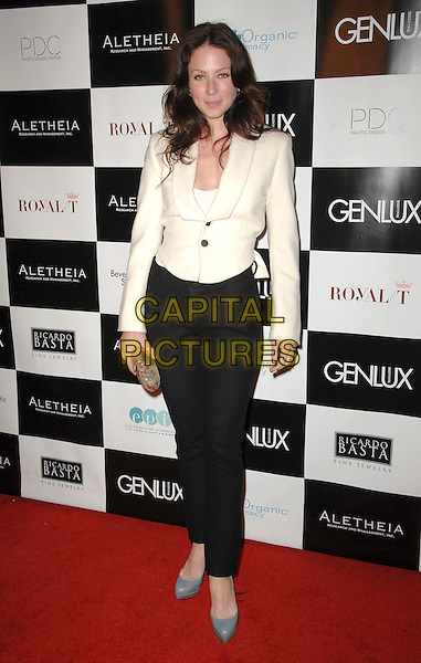 LYNN COLLINS .Genlux Magazine's BritWeek Designer Of The Year Fashion Show & Awards held At The Pacific Design Center, West Hollywood, California, USA, .2nd May 2009..full length cream cropped tuxedo jacket black trousers grey gray shoes high waisted clutch bag gold .CAP/ADM/KB.©Kevan Brooks/Admedia/Capital Pictures