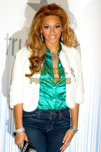 BEYONCE KNOWLES .At The True Star Perfume Launch Held At Macy's, Herald Square, New York City..October 22nd, 2004.half length, white fur coat, bangles, bracelets, green silk, satin blouse, unbuttoned.www.capitalpictures.com.sales@capitalpictures.com.©Capital PIctures