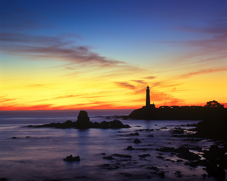 Pigeon Point Lighthouse at sunset. Built in 1871, named after ship Carrier Pigeon that wrecked here in 1853. Tallest lighthouse (tied with Point Arena) on the West Coast of the US at 115 ft (35 m); still an active Coast Guard aid to navigation (outside aerobeacon). Lantern room of tower equipped with original first-order, 1000-watt Fresnel lens. Illuminated for demonstration purposes only today, lens has 24 flash panels, is composed of 1008 hand-polished lenses and prisms and is capable of producing over 500,000 candlepower illumination. Manufactured by the Henry-LePaute company in Paris, France; first lit at Pigeon Point on November 15, 1872. San Mateo County, CA.
