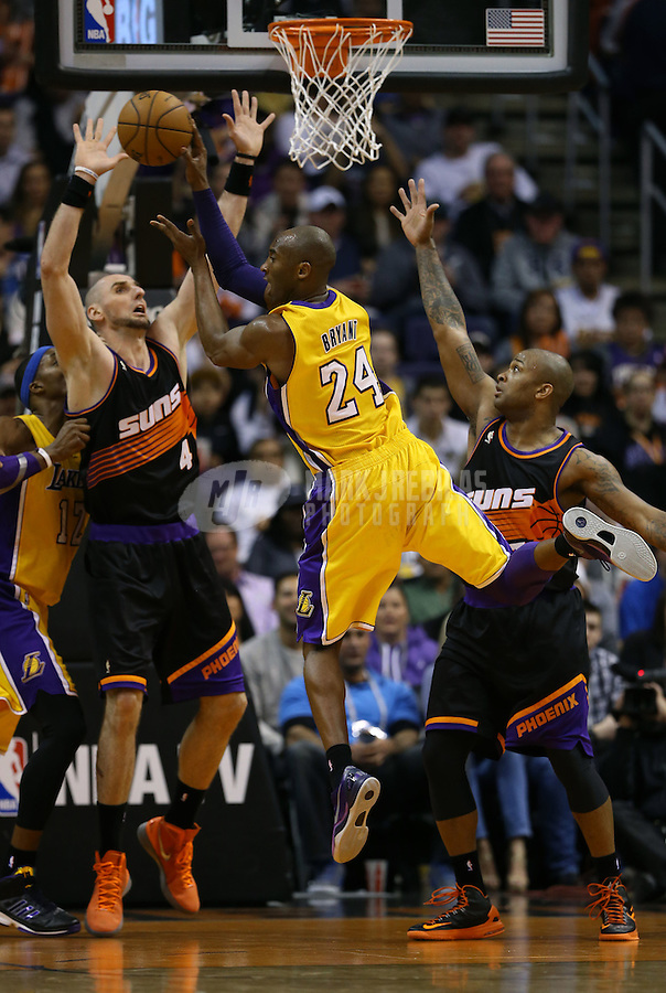 Jan. 30, 2013; Phoenix, AZ, USA: Los Angeles Lakers guard Kobe Bryant (24) drives to the basket past Phoenix Suns forward P.J. Tucker (right) and center Marcin Gortat at the US Airways Center. Mandatory Credit: Mark J. Rebilas-