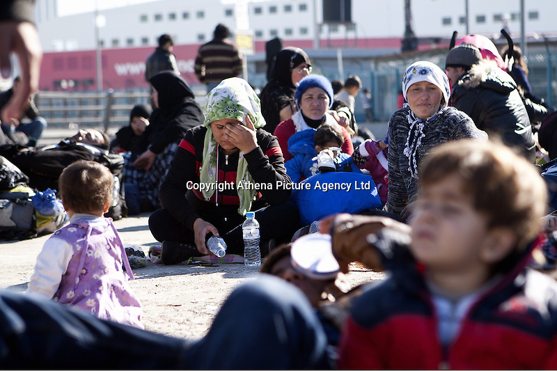 Pictured: Female migrants gather at the port Monday 22 February 2016<br /> Re: Thousands of migrants, most from Syria, have landed to the port of Pireaus, after crossing the border from Turkey to various islands like Lesvos and Kos in Greece.