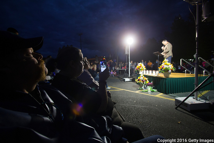 BURLINGTON, WA - SEPTEMBER 26: Hundreds gather and listen to Burlington Mayor Steve Sexton speek during a candlelight vigil outside the Cascade Mall on September 26, 2016 in Burlington, Washington. Five people were shot and killed by a gunman several nights ago. The suspect, Arcan Cetin, 20, a resident of Oak Harbor, Washington, made a court appearance today. (Photo by Karen Ducey/Getty Images)
