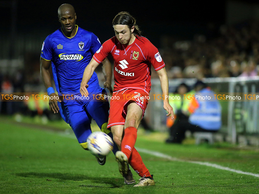 Ben Tilney of MK Dons crosses the ball into the AFC Wimbledon penalty area during AFC Wimbledon vs MK Dons, Sky Bet EFL League 1 Football at the Cherry Red Records Stadium on 14th March 2017