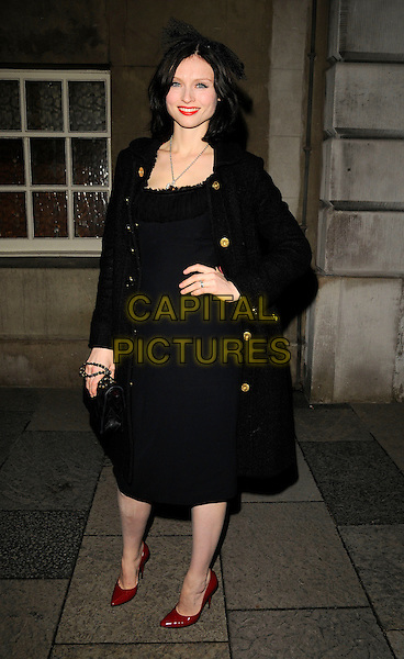 SOPHIE ELLIS BEXTOR.The Vivienne Westwood & London Musici concert & catwalk show, Chaos Point, in aid of NSPCC, Banqueting House, Whitehall, London, England..November 18th, 2008.full length black jacket coat dress red shoes hand on hip .CAP/CAN.©Can Nguyen/Capital Pictures.