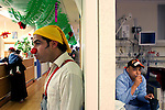 "Mustafah Mshasha, a Palestinian boy from the Old City of Jerusalem receives chemotherapy at the Oncology Day Care unit at Hadassah Ein Karem hospital, as clown Dudi (Dudy Barashi an Israeli  medical clown who works in Hadassah member of a group call ""Dream Doctor"") visits other patients. ..Mustafa suffers from Leukemia and has been treated in the Children Oncology Unit. Photo by Quique Kierszenbaum"