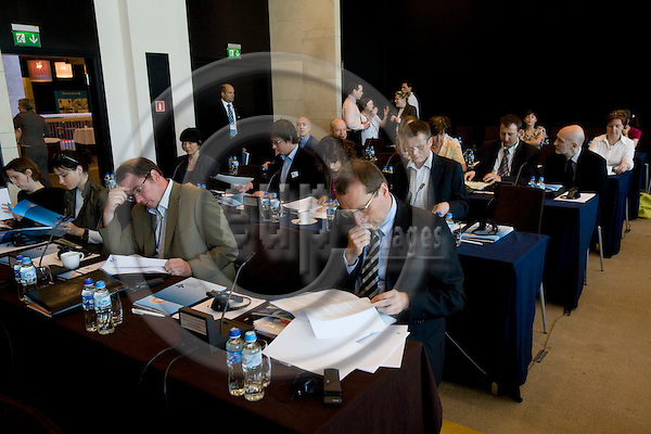 POZNAN - POLAND - 4 JUNE 2008 -- Conference on global competition and European companies' location decisions. People reading the information material from Eurofound. Photo: Erik Luntang/EUP-IMAGES