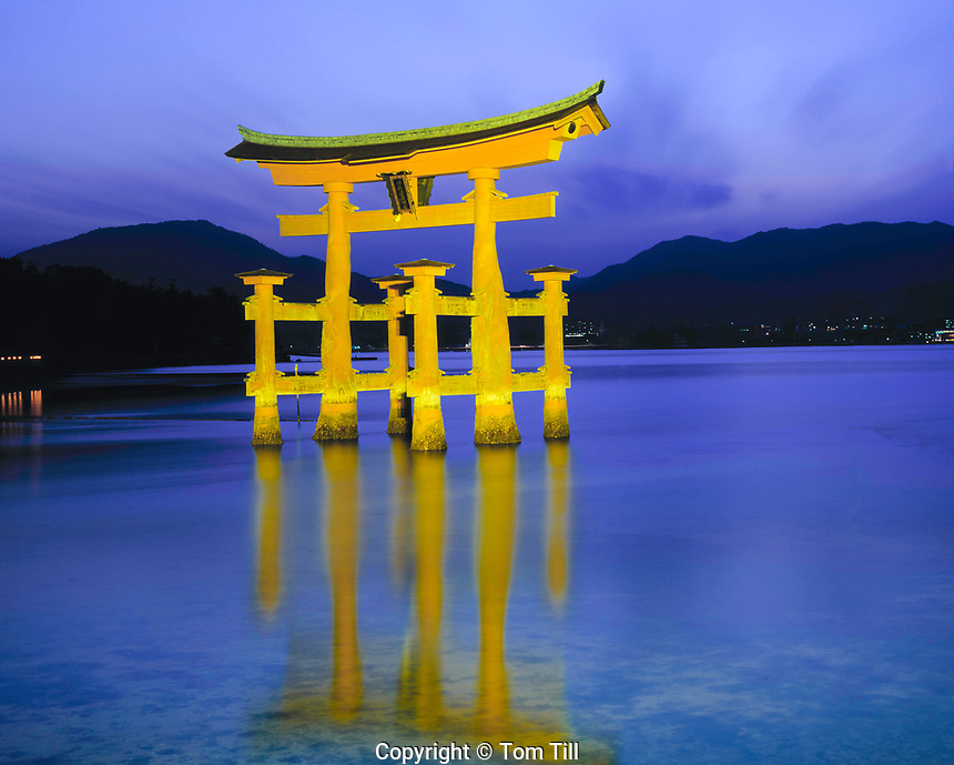 The Floating Torii, Miyajima Island, Japan   Symbol of Japan built in 1875    Mountains and inland sea beyond