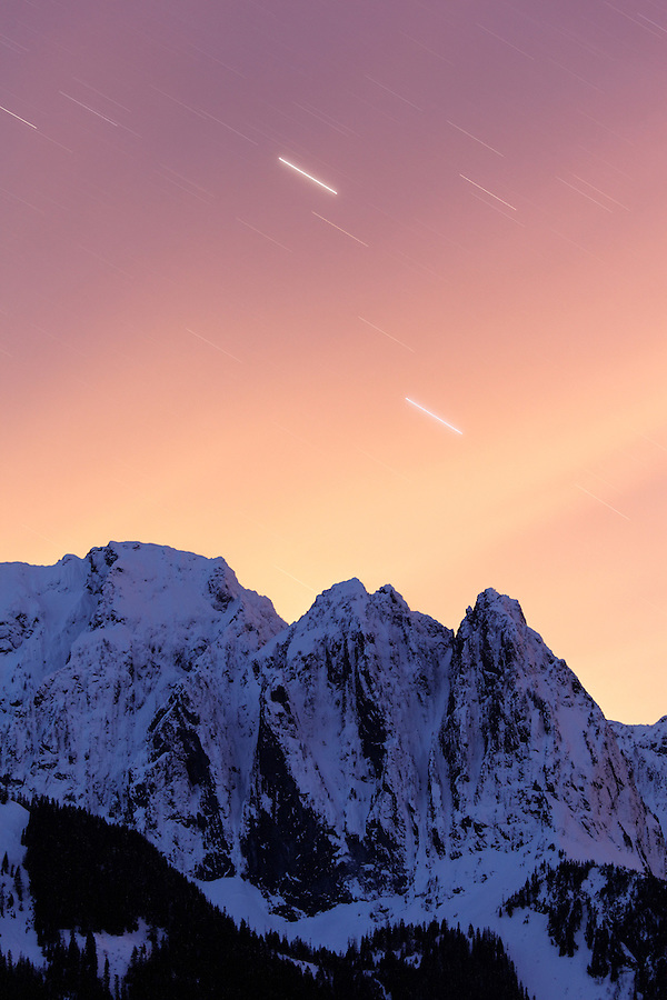 Star trails in night-time sky over Mount Index, Central Washington Cascade Mountains, Snohomish County, Washington, USA