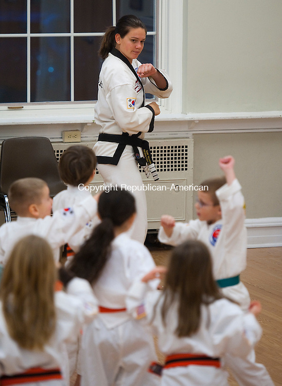 MIDDLEBURY, CT--- -012816JS03--Instructor Jessica O'Connor, a 4th degree black belt, teaches a class to youngsters during the Middlebury Parks and Recreation's karate class Friday at the Shepardson Community Center in Middlebury. O'Connor is from USA Martial Arts of Naugatuck. <br /> Jim Shannon Republican-American