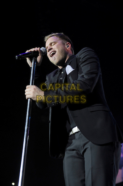 Olly Murs.performing live in concert, o2 arena, Greenwich, London, England. .30th March 2013.on stage gig performance music half length black suit singing .CAP/MAR.© Martin Harris/Capital Pictures.