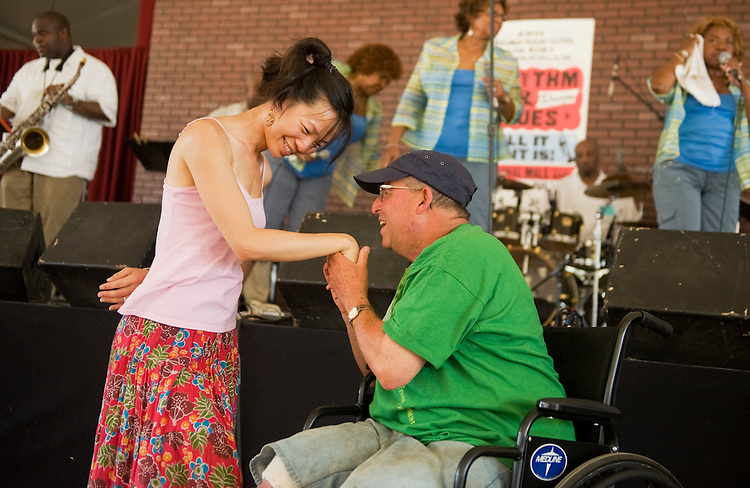 UNITED STATES - JULY 07:  Charles Minkowitz of Foggy Bottom, thanks Shirley Pavetto of Rockville, for a dance after a performance by the Dixie Cups in the Rhythm and Blues section of the Smithsonian Folklife Festival held on the National Mall.  This year's festival features the country of Colombia, Rhythm and Blues music, and the Peace Corps.  (Photo By Tom Williams/Roll Call)