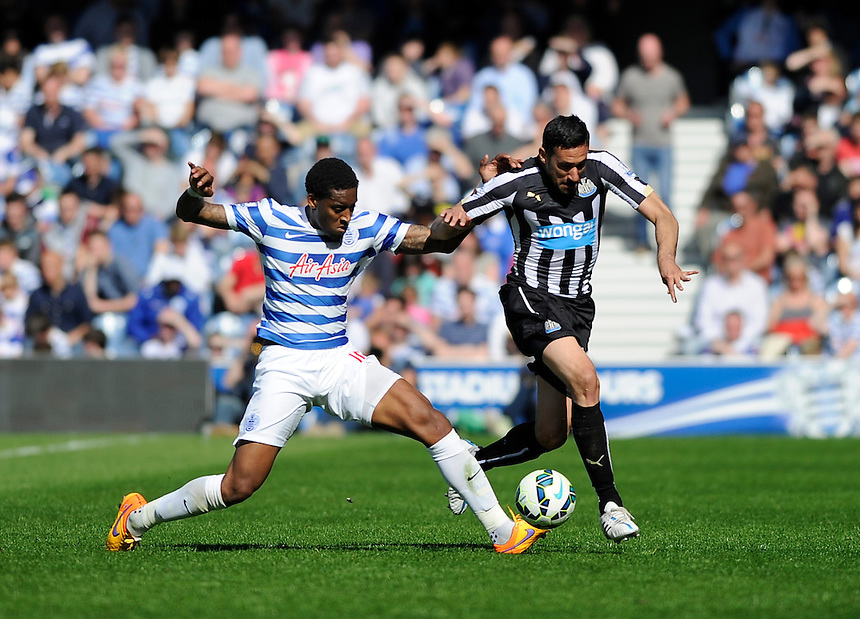 Newcastle United's Jonas Gutierrez holds off the challenge from Queens Park Rangers' Leroy Fer<br /> <br /> Photographer Ashley Western/CameraSport<br /> <br /> Football - Barclays Premiership - Queens Park Rangers v Newcastle United - Saturday 16th May 2015 - Loftus Road - London<br /> <br /> &copy; CameraSport - 43 Linden Ave. Countesthorpe. Leicester. England. LE8 5PG - Tel: +44 (0) 116 277 4147 - admin@camerasport.com - www.camerasport.com