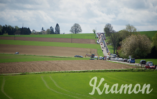 the peloton/race caravan stretches across the landscape<br /> <br /> 101th Liège-Bastogne-Liège 2015