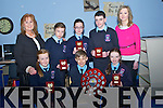 The pupils of Ardfert Primary School who were the champion in the All Ireland Debate Competition over the St Patrick's week-end inThe UCD . with their teachers on Wednesday with their trophies in their school, Front l-r: Ailíse Ryan, David Fitzgerald (capt) and Jessica Murphy. Back l-r: Trevor Leen, Claudia Murphy, Betty Stack (principal) Marie O'Connell (teacher) and Aisin Le Gros.