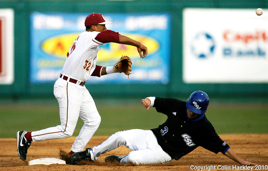 TALLAHASSEE, FL 10-FSU-GA.ST. BASE10 CH14-Florida State's Sherman Johnson makes the first part of a double play on Georgia State's Carl Moniz during third inning action Friday at Dick Howser Stadium in Tallahassee. The Seminoles beat the Panthers 11-3 in the 2010 season opener...COLIN HACKLEY PHOTO