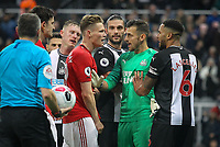 Scott McTominay of Man Utd involved in heated exchange with Goalkeeper Martin Dubravka of Newcastle United at full time during the Premier League match between Newcastle United and Manchester United at St. James's Park, Newcastle, England on 6 October 2019. Photo by J GILL / PRiME Media Images.
