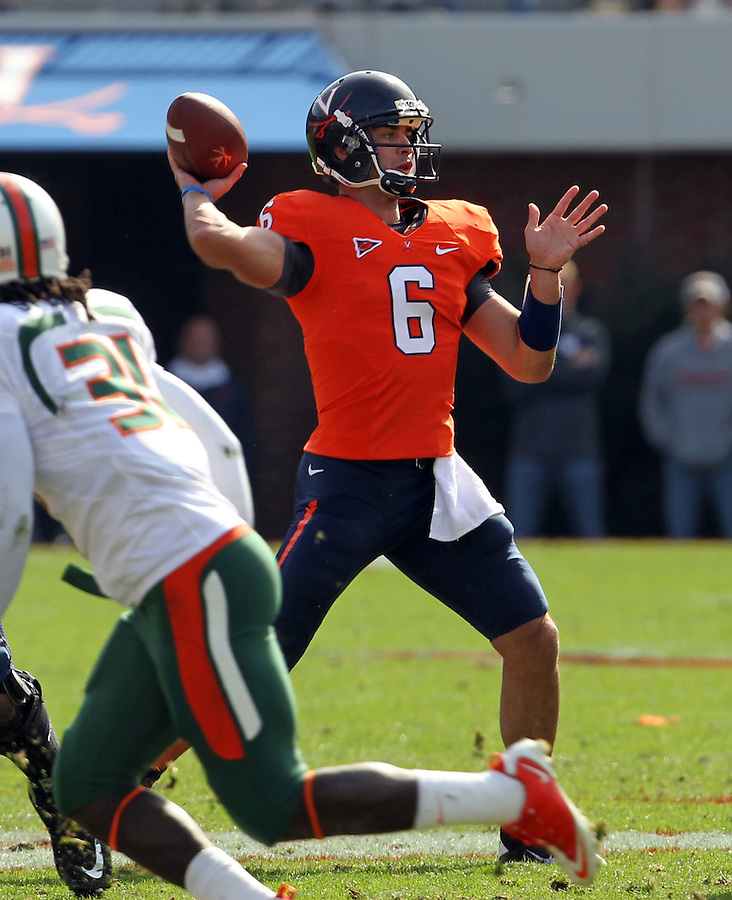 Oct 30, 2010; Charlottesville, VA, USA; Virginia Cavaliers quarterback Marc Verica (6) throws during the 1st half of the game against the Miami Hurricanes at Scott Stadium.  Mandatory Credit: Andrew Shurtleff