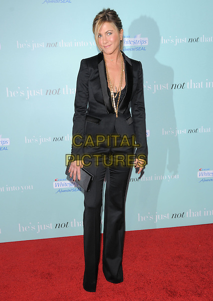 "JENNIFER ANISTON.""He's Just Not That Into You"" Los Angeles Premiere at Grauman's Chinese Theatre, Hollywood, CA, USA..February 2nd, 2009 .full length black trouser suit pant jacket blazer gold jewellery necklaces tux tuxedo blazer clutch bag trousers.CAP/DVS.©Debbie VanStory/Capital Pictures."