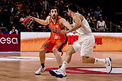 25th March 2018, Madrid, Spain; Endesa Basketball League, Real Madrid versus Valencia; Guillem Vives (Valencia Basket) brings the ball foward against Facundo Campazzo (Real Madrid Baloncesto)