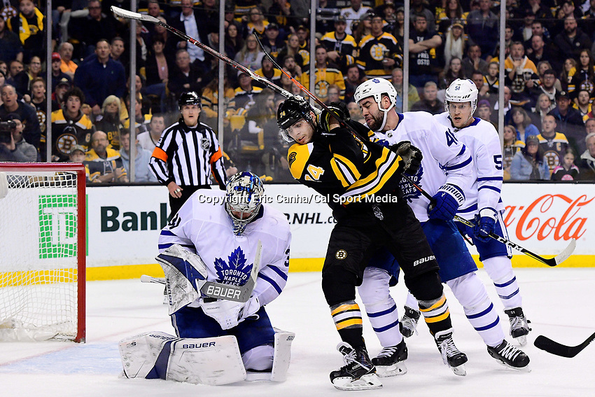 April 21, 2018: Toronto Maple Leafs goaltender Frederik Andersen (31) catches the puck as Boston Bruins left wing Jake DeBrusk (74) and defenseman Roman Polak (46) battle in front of him during game five of the first round of the National Hockey League's Eastern Conference Stanley Cup playoffs between the Toronto Maple Leafs and the Boston Bruins held at TD Garden, in Boston, Mass. Toronto defeats Boston 4-3, Boston leads Toronto 3 games to 2 in the best of 7 series.